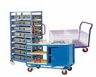 Workshop and manufacturing trucks including container storage trolleys